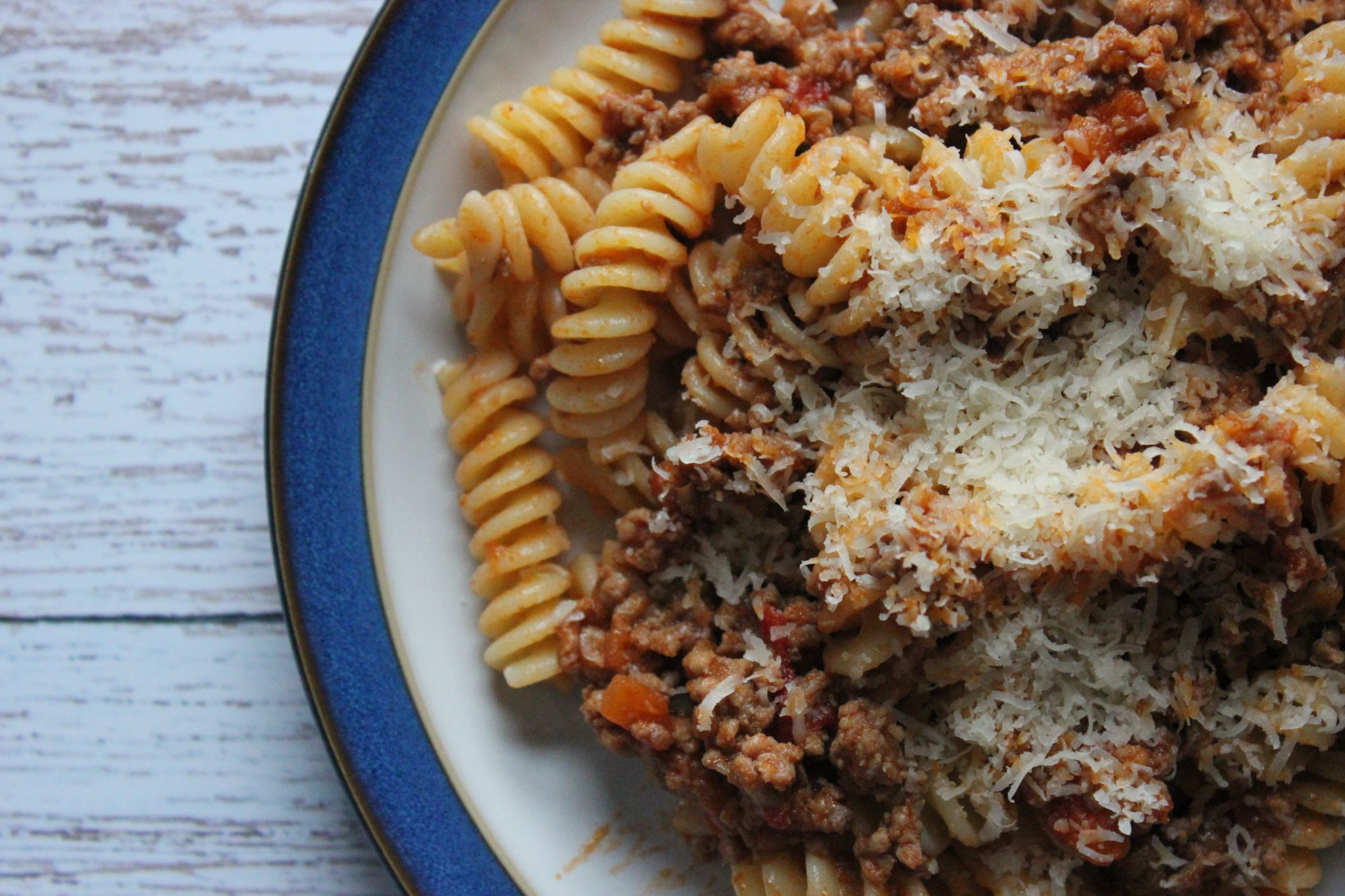 A plate of pasta with ragu